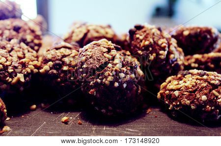 chocolate cookies with nuts on the table