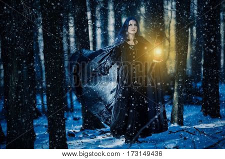 Sorceress and the lamp in the magic forest