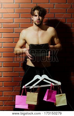 Bearded Muscular Sexy Man With Hangers Holds Shopping Bag, Package