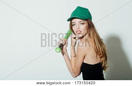 Pretty Sexy Woman With Long Hair Holds Green Baseball Bat