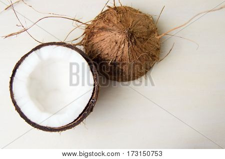 Halved Coconut On A Wooden Table