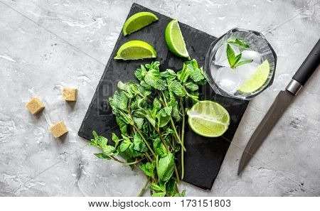 making mojito on stone background top view.