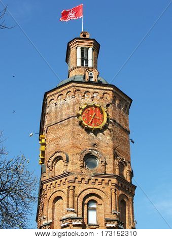 Old building tower with red clock in Ukraine Vinnitsa