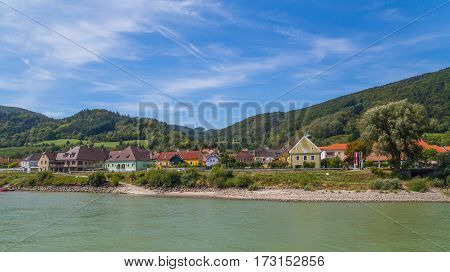 WACHAU AUSTRIA - 28TH AUGUST 2015: Colourful buildings along the Danube River in the Wachau Valley.