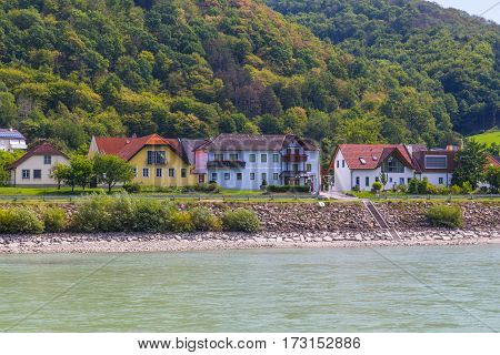 WACHAU VALLEY AUSTRIA - 28TH AUGUST 2015: Buildings along the waterfront in Krems in the Wachau Valley. Wineries can be seen.