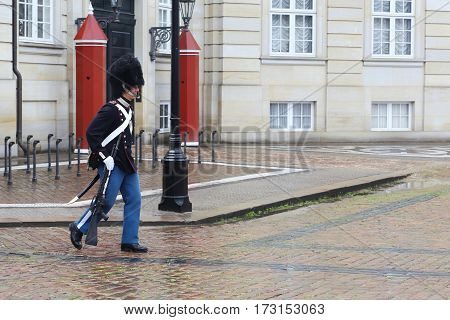 COPENHAGEN, DENMARK - JUNE 29, 2016: This is guard who had just passed the guard post at the Amalienberg Castle.
