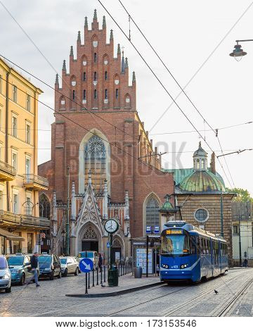 KRAKOW POLAND - 15TH OCTOBER 2016: Tram and buildings along streets in Krakow in the morning.