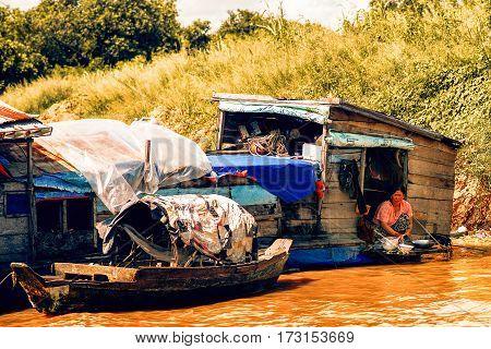 Tonle Sap Lake Siem Reap Cambodia - July 13 2013: Cambodian people live on Tonle Sap Lake in Siem Reap Cambodia. Unidentified people in a Floating village on the Tonle Sap Lake
