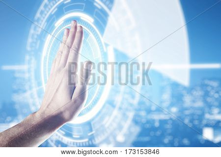 Male palm against abstract digital circle on blurry night city background. Technology concept