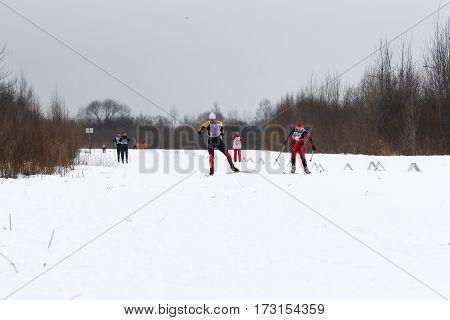 Kirishi, Russia - 11 February, People on the ski run between the bushes, 11 February, 2017. Mass ski race Russian Ski Track.