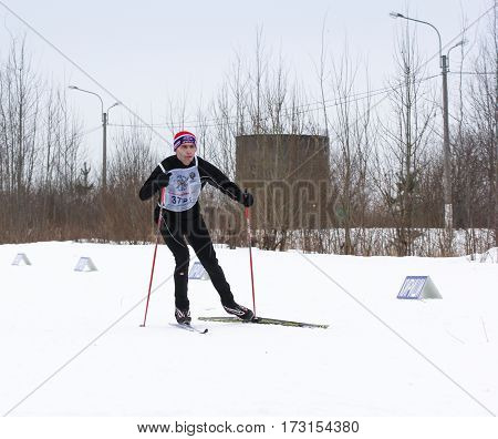 Kirishi, Russia - 11 February, The man on skis, 11 February, 2017. Mass ski race Russian Ski Track.