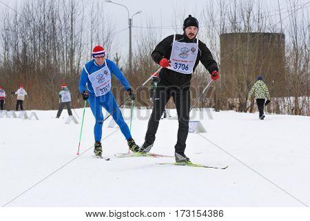 Kirishi, Russia - 11 February, People walking along the ski trail, 11 February, 2017. Mass ski race Russian Ski Track.