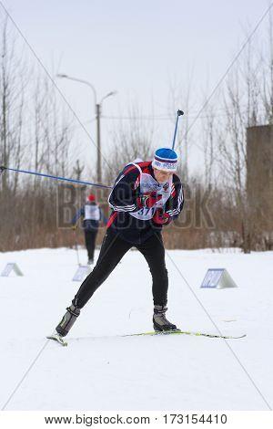 Kirishi, Russia - 11 February, Man rolling on skis, 11 February, 2017. Mass ski race Russian Ski Track.