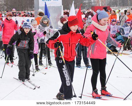 Kirishi, Russia - 11 February, The mass arrival of teenagers, 11 February, 2017. Mass ski race Russian Ski Track.