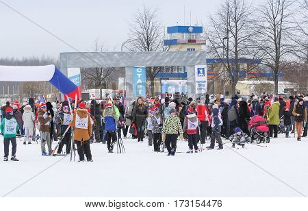 Kirishi, Russia - 11 February, Large crowd of people on a winter holiday, 11 February, 2017. Mass ski race Russian Ski Track.