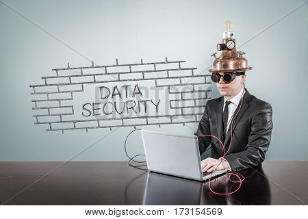 Data security text with vintage businessman using laptop at office