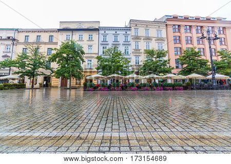 KRAKOW POLAND - 16TH OCTOBER 2016: Buildings along the outside of Rynek Glowny. Restaurants can be seen.