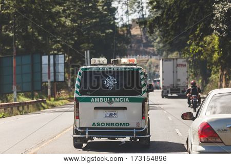 Ambulance driving down a busy road in Guatemala Central America.