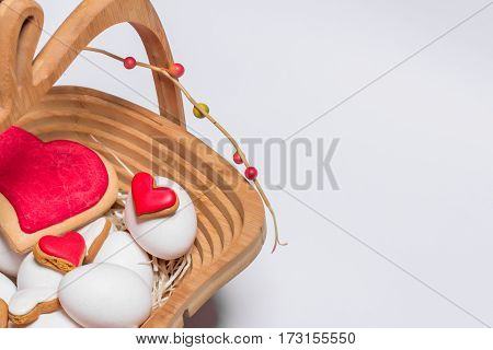 Easter card with eggs and biscuits in the form of hearts close up with copy space.