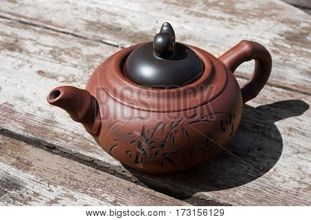 earthenware teapot with a pattern on a table