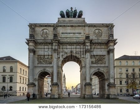 MUNICH, GERMANY - OCTOBER 31, 2015: The Siegestor (Victory Gate) in Munich is a three-arched triumphal arch crowned with a statue of Bavaria with a lion-quadriga