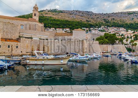 DUBROVNIK CROATIA - 11TH AUGUST 2016: A view of buildings and boats in Old Town Dubrovnik during the morning in the summer.