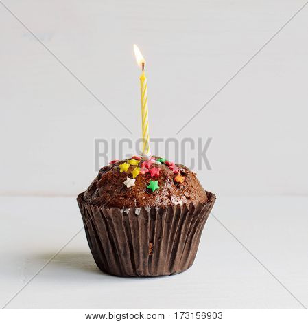 Birthday first year chocolate muffin with a candle