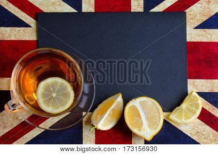 Black Copy Space For Your Text On Background Of British Flag With A Cup Of Lemon Tea