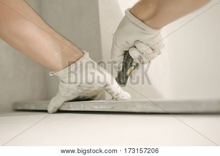 Construction Worker Using Spirit Level At Home Interior