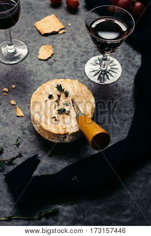 Round French Cheese on Slate Table with Knife