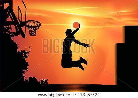 athlete playing basketball in the street at sunset background