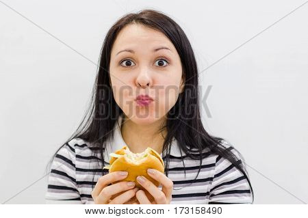 Young Girl Holding In Female Hands Fast Food Burger, American Unhealthy Calories Meal On Background,