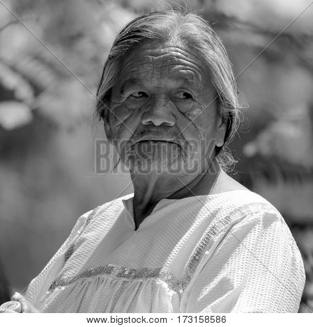 PHOENIX ARIZONA APRIL 23 2014:  Old woman Navajo are a Native American people Navajo Nation constitutes an independent governmental body that manages the Navajo reservation in the Four Corners area