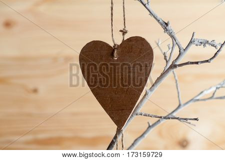 Heart Made Of Cloth On White Branch.