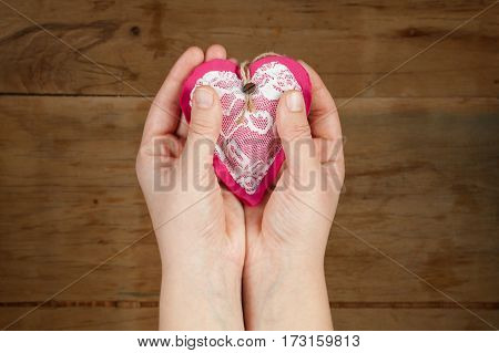 Heart From Clothing In Hand.