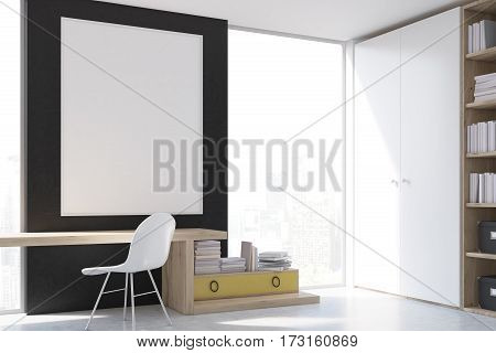 Stylish workplace at home with a computer a yellow drawer with book stacked on it a large bookcase and a tall window. Large vertical poster is hanging on the black wall. 3d rendering. Mock up.
