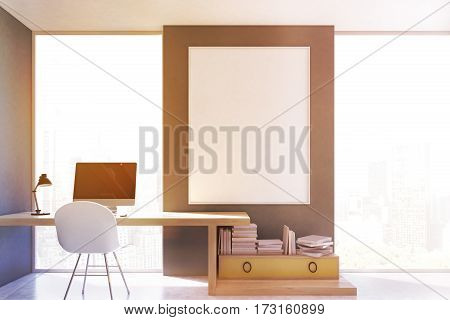 Stylish workplace at home with a computer and a yellow drawer with book stacked on it. Large vertical poster is hanging on the gray wall. 3d rendering. Mock up. Toned image