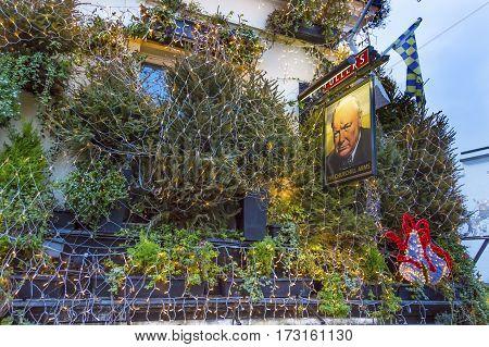 LONDON, ENGLAND - JANUARY 16, 2017 The Churchill Arms Pub Restaurant Kensington London England. Famous pub and restaurant in London. Stared as a pub in 1750. Became Churchill Arms in World War 2 because Churchill's parents used to visit the pub.