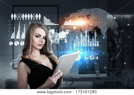 Portrait of a businesswoman with a tablet computer standing on a deck of a spaceship with graphs drawn on a glassboard. Toned image.