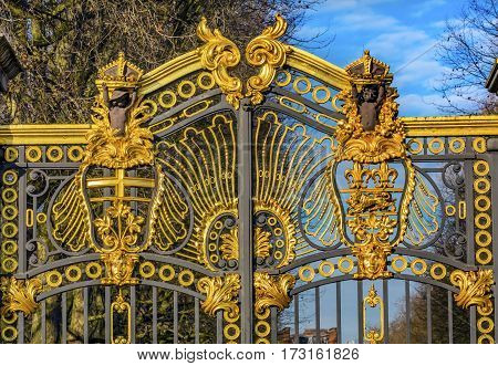 LONDON, ENGLAND - JANUARY 17, 2017 Golden Canada Maroto Gate Buckingham Palace London England. Created in 1901 as a memorial to Queen Victoria who died in 1901 and is the entrance to Green Park. The Gate leads to Trafalgar Square. Designed by Aston Webb w