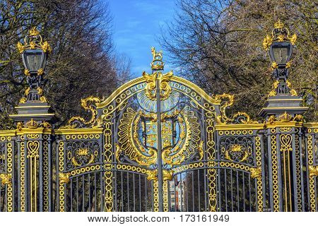 LONDON, ENGLAND - JANUARY 17, 2017 Golden Canada Maroto Gate Buckingham Palace London England.  Created in 1901 as a memorial to Queen Victoria, who died in 1901 and is the entrance to Green Park.  The Gate leads to Trafalgar Square. Designed by Aston Web