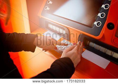 Woman Entering Pin Code