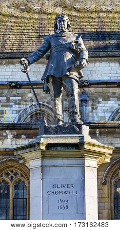 Oliver Cromwell Statue Houses of Parliament Westminster London England. Outside the House of Commons erected 1899 sculpted by Hamo Thornocroft. Oliver Cromwell was the dictator who took over England in the Civil War in the 1650s. A General he signed King