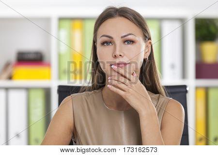 Portrait Of A Pensive Businesswoman In Beige