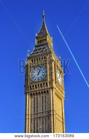 Big Ben Tower Plane Houses of Parliament Westminster London England. Named after the Bell in the Tower. Has kept exact time since 1859.