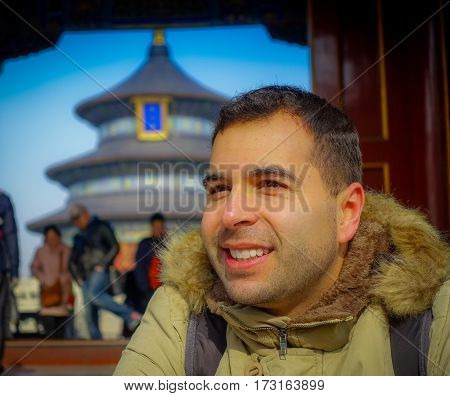 BEIJING, CHINA - 29 JANUARY, 2017: Temple of heaven, imperial complex with spectacular religious buildings located at southeastern central city area, tourist posing happily, beautiful circular ancient structure behind.