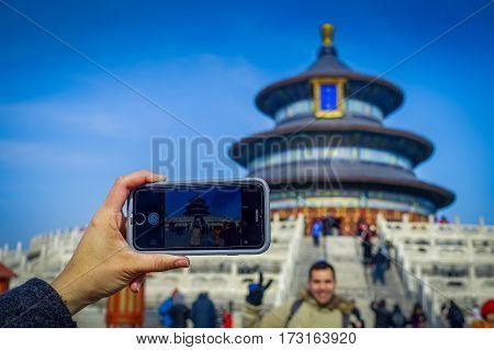 BEIJING, CHINA - 29 JANUARY, 2017: Mobile phone shooting picture, beautiful circular structure inside temple of heaven compound, imperial complex various religious buildings located in southeastern central city area.