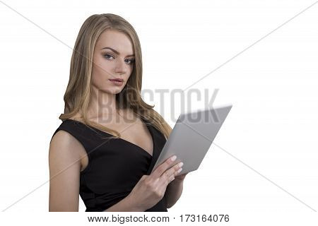 Isolated portrait of a gorgeous businesswoman holding her tablet computer and wearing a beautiful black dress.