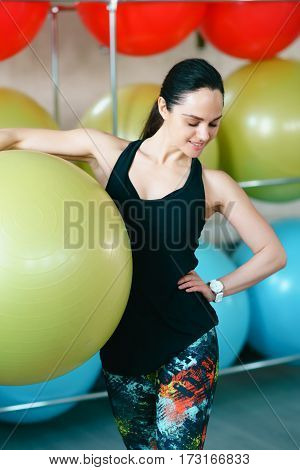 Fitness Woman Standing In The Hall With A Large Ball Sports