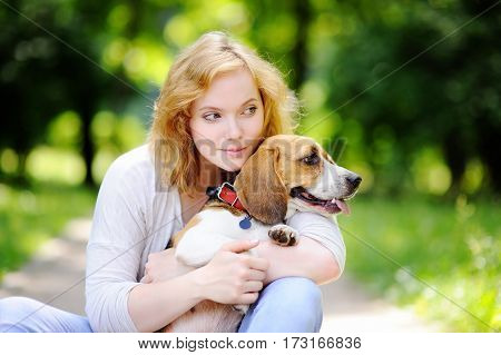 Young Beautiful Woman With Beagle Dog